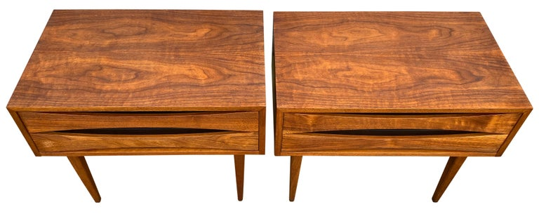 Beautiful pair of Mid-Century Modern solid walnut nightstands style of Arne Vodder. Beautiful design American made circa 1960. Solid walnut and black lacquer details. Very clean drawer interiors. Made by West Michigan Furniture Company USA.