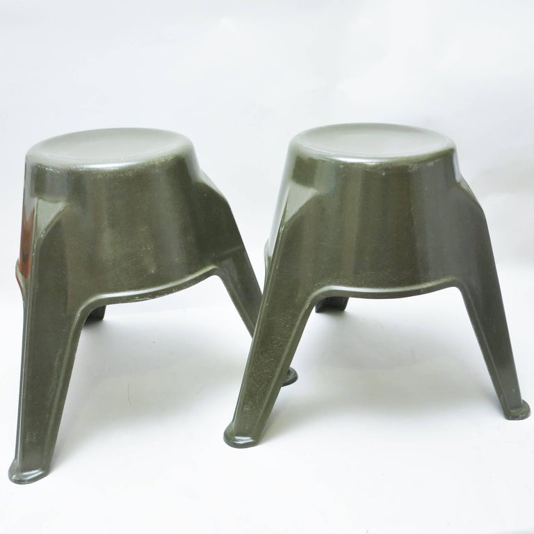 Rare pair of Mid-Century Modern stackable stools in olive green fiberglass. German work of the 1960s.
