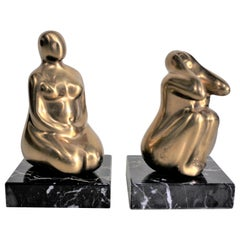 Pair of Mid-Century Modern Stylized Nude Female Gilt Bronze Sculptures