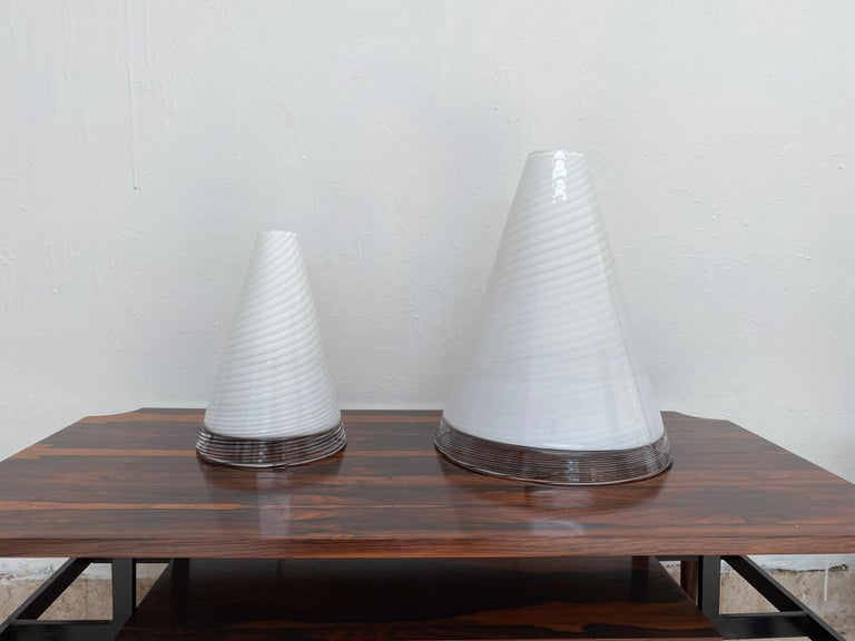 """Mid-Century Modern set of table lamps executed in Hand-blown Murano Glass in the shape of Cones.  The top is in a white swirl pattern and the base in black """"tessuto"""".  Both have the original labels that read """"GT, Toso Selezione, Murano"""" (faintly"""