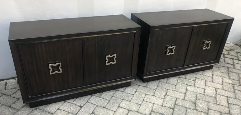 Beautiful pair of Tommi Parzinger large scale nightstands, storage cabinets or small credenzas, one adjustable shelf in each.