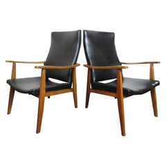 Pair of Mid-Century Modern Vinyl Lounge Chairs