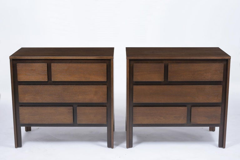 A pair of modern dressers handcrafted out of mahogany wood and features a new two-tone walnut color stain with a satin lacquered finish. The chests come with five drawers that offer plenty of storage space, all drawers open and close with ease, and