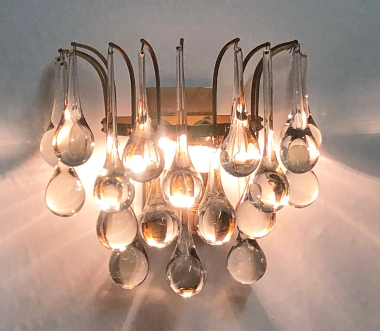Precious, elegant pair of midcentury brass and Murano crystal drops wall lights by E.Palme, Germany, circa 1960s.