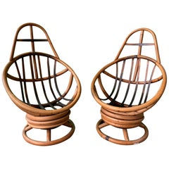 Pair of Midcentury Rattan Rocking Swivel Lounge Chairs