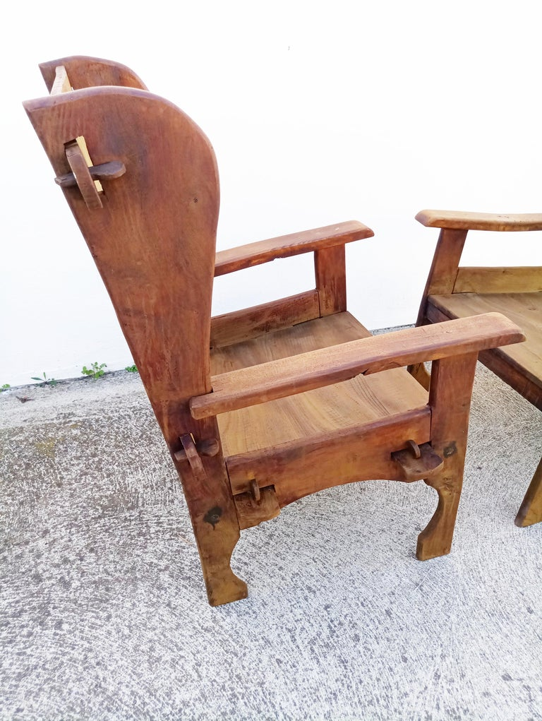 Rare pair of midcentury Scottish Brutalist wooden armchairs. In very good vintage condition.