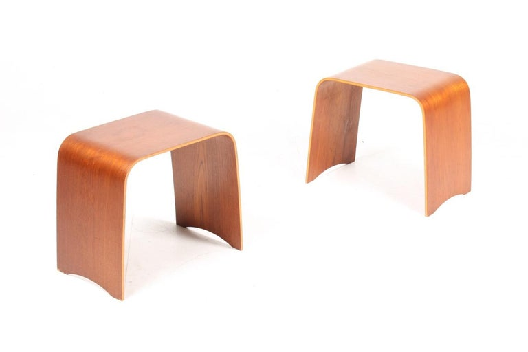 A pair side tables or nightstands in teak. Designed and made by Fritz Hansen in 1960s. Great original condition.