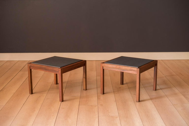 Vintage pair of side tables designed by Jack Cartwright for Founders, circa 1960s. This set features a square parson style supporting frame in walnut and a removable slate tile top. Price is for the pair.
