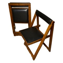 Pair of Mid Century Solid Mahogany Vinyl Folding Compact Campaign Style Chairs