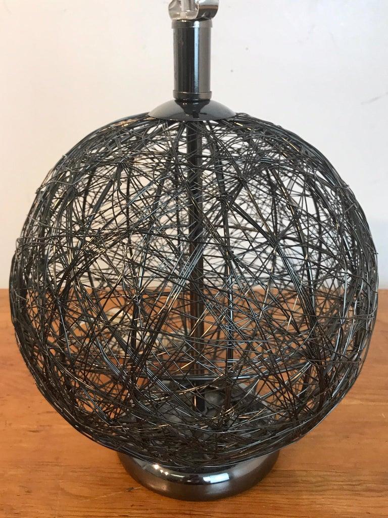 Patinated Pair of Midcentury Spun Gun Metal Sphere Lamps For Sale