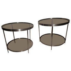 Pair of Midcentury Stainless Steel Round End Tables with Smoked Glass Shelves