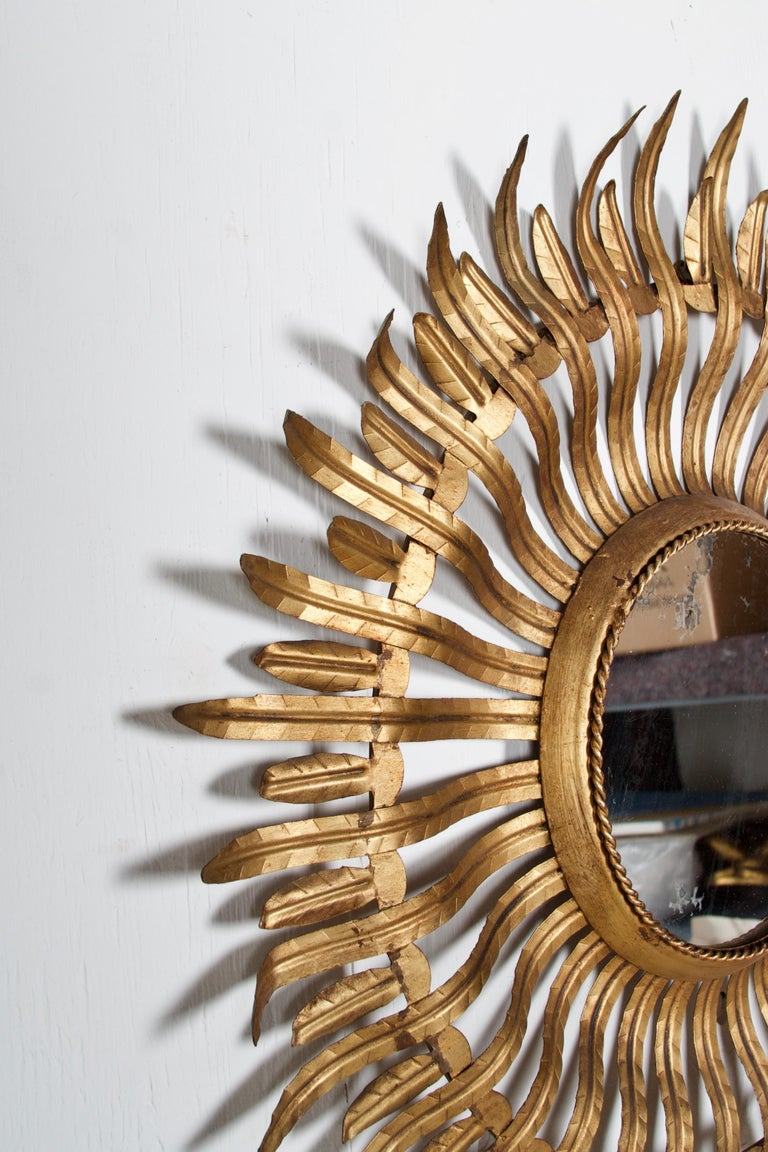 A stunning pair of gilt metal and original mirror glass, mirrors.