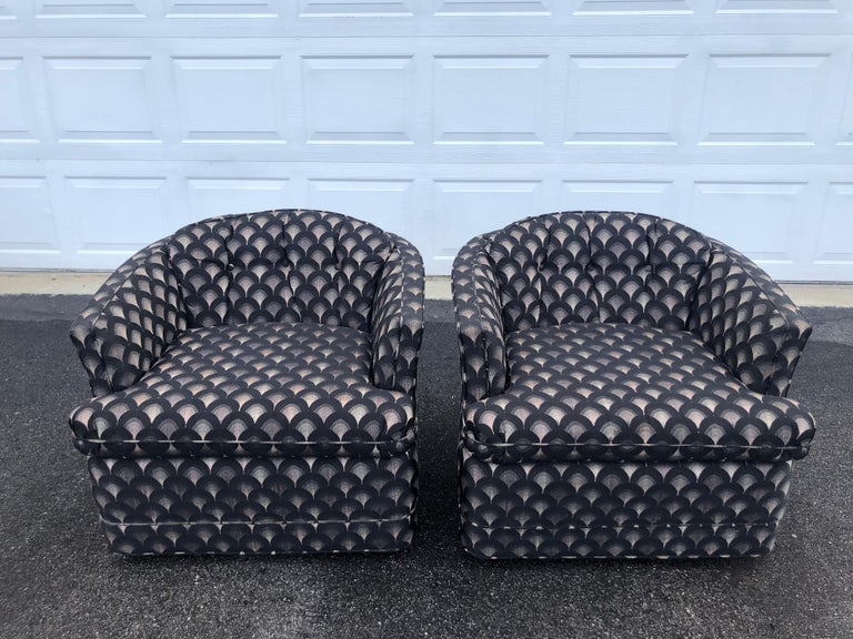 Pair of Mid Century swivel club chairs. Art Deco designed upholstery with black , gray and white arched rainbow shape. Solid heavy construction. Very durable original upholstery. Seat width is 20-21
