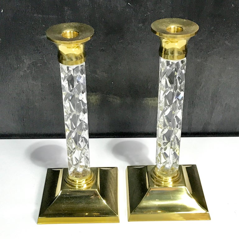 Pair of midcentury waterford crystal and brass candlesticks.