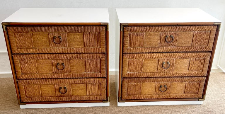 Pair of mid century white lacquered faux rattan chests or nightstands, each one of rectangular form, fitted with three 28