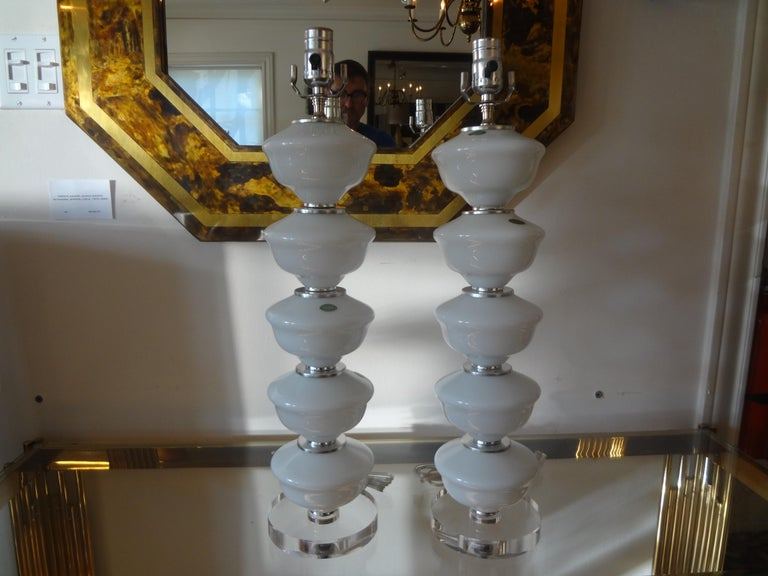 Stunning pair of midcentury Italian white Murano opaline glass lamps by Balboa. This great pair of Hollywood Regency stacked Murano glass lamps have new Lucite bases. Featured blown Murano glass lamps and are newly wired for the U.S. Market. These