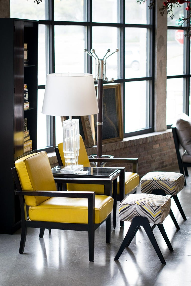 Solid and comfortable Mid-Century Modern armchairs with dark stained frames and yellow leather seat and back cushions. Measure: Seat height 18 inches.  See coordinating striped ottoman in photographs, listing: LU1140215651882.
