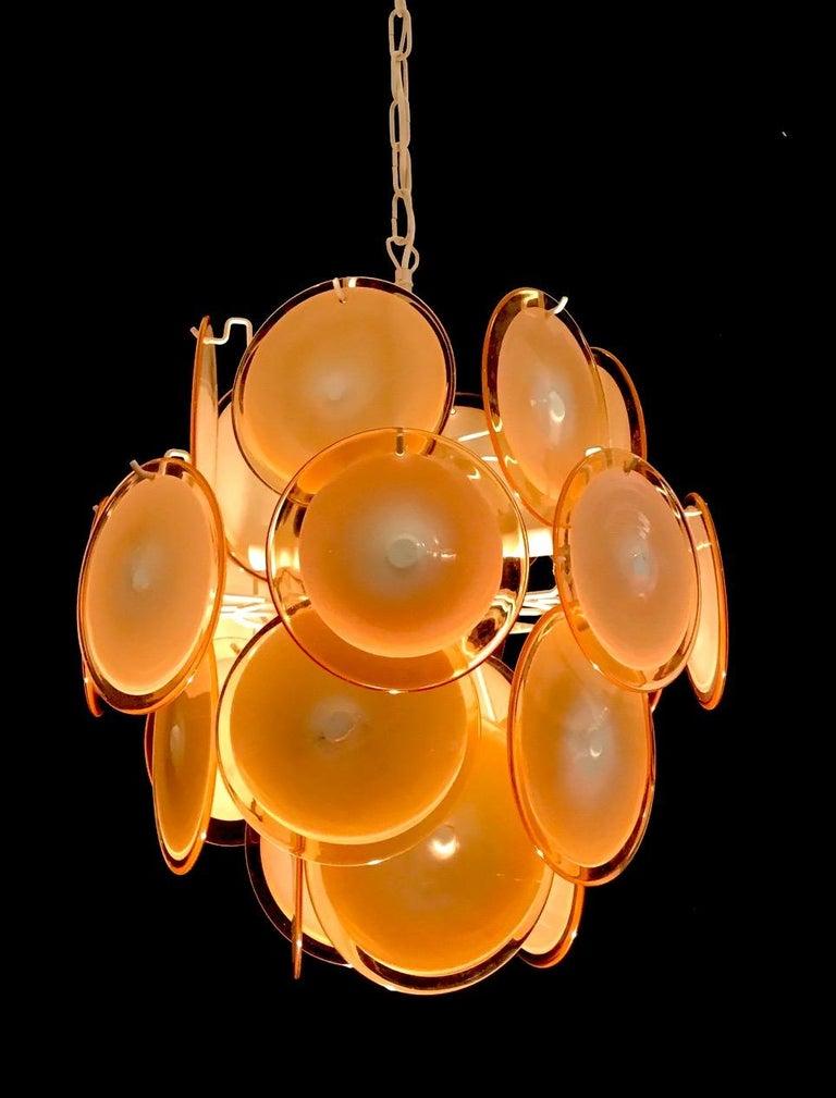 Mid-Century Modern Pair of Midcentury Amber Murano Glass Discs Italian Chandeliers, 1970s For Sale