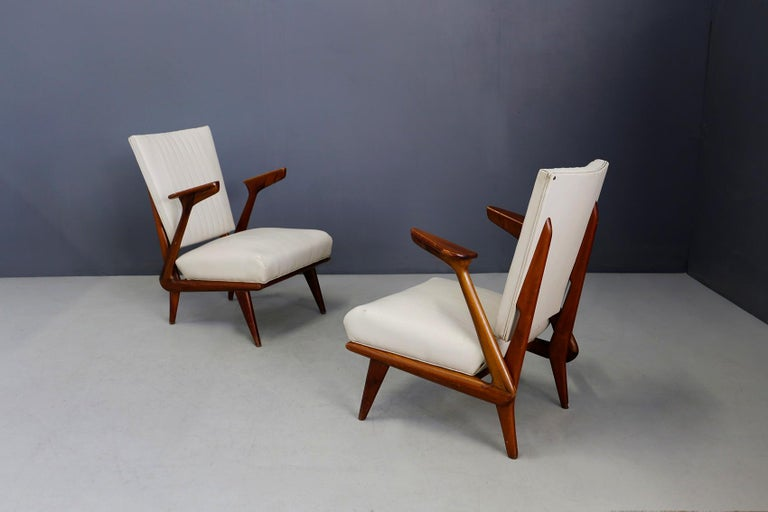 Beautiful pair of armchairs made by Giuseppe Scapinelli in 1950-1960. The structure of the armchair is in solid wood. The seat and backrest cover is in Sky White-ivory. The padding is finely worked and is in good condition. The peculiarity of the