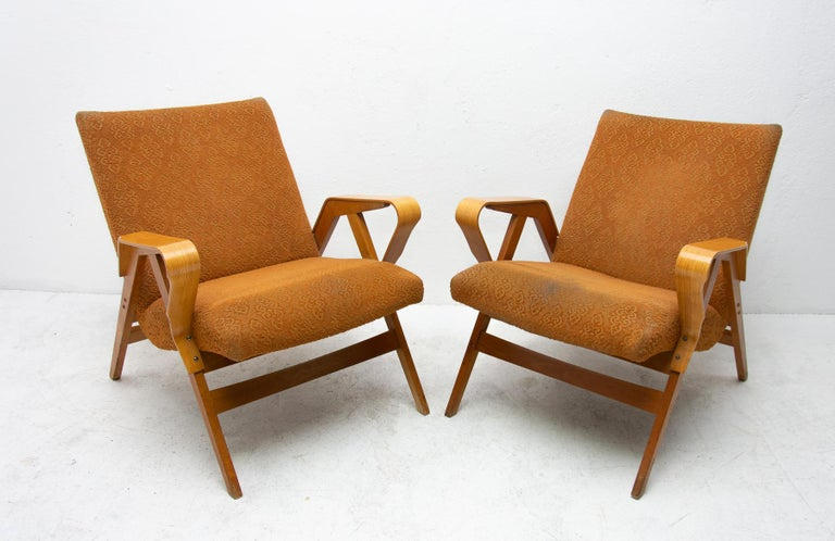 These Czechoslovak lounge armchairs No.24-23 were designed by František Jirák for Tatra Nabytok in the former Czechoslovakia in the 1960s. The design of these chairs followed the huge success of the Czechoslovak pavilion at the Brussels Expo