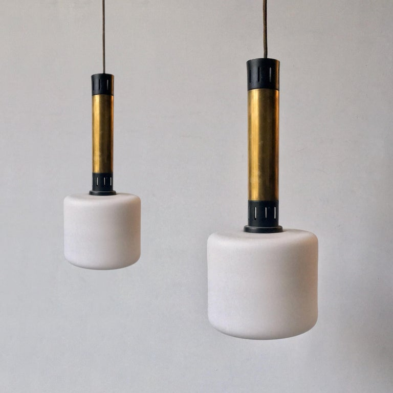 Mid-Century Modern Pair of Midcentury Brass and Satin Glass Pendant Lights Attributed to Stilnovo For Sale