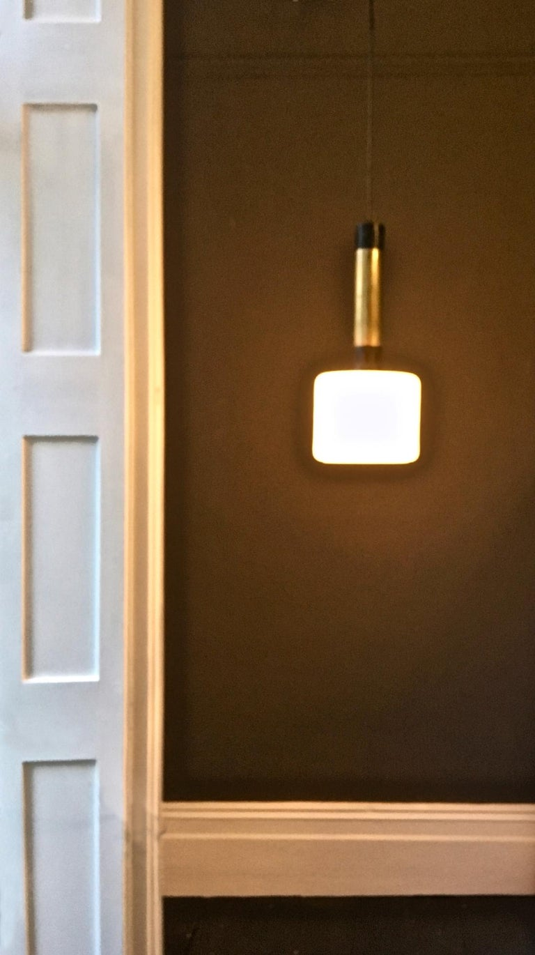 Italian Pair of Midcentury Brass and Satin Glass Pendant Lights Attributed to Stilnovo For Sale