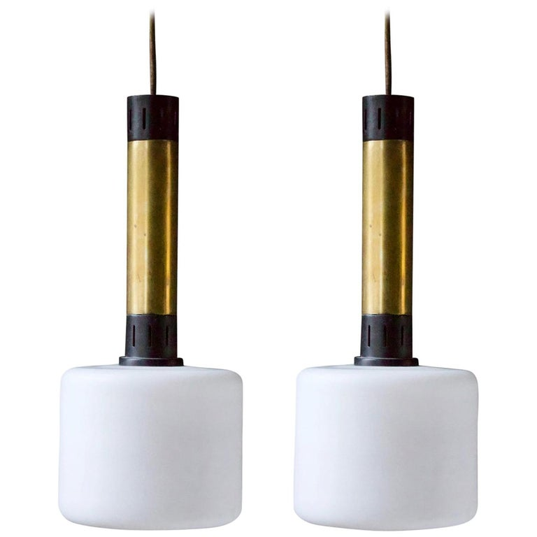 Pair of Midcentury Brass and Satin Glass Pendant Lights Attributed to Stilnovo For Sale