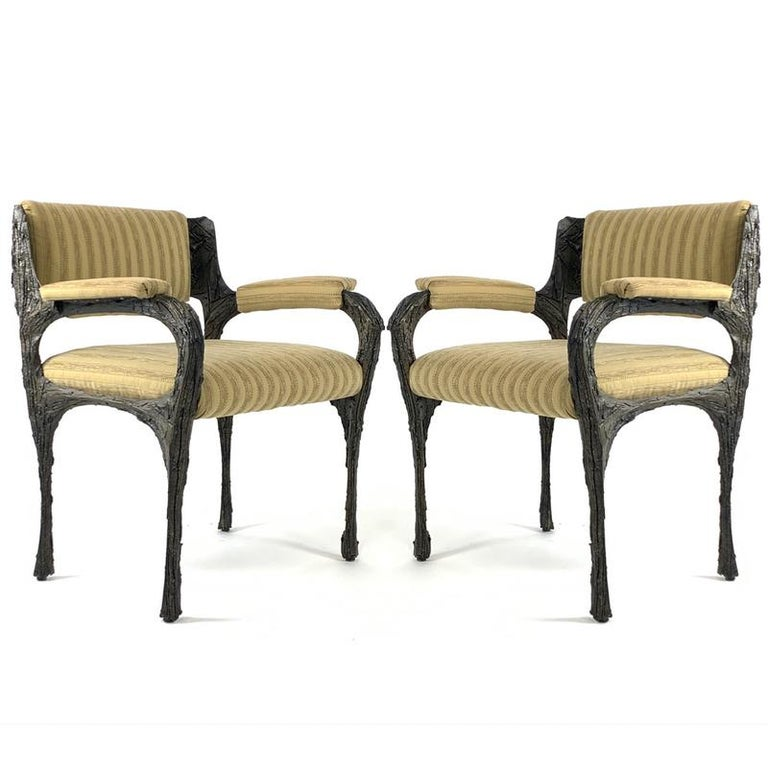 Pair of highly collectable Paul Evans sculpted bronze armchairs. Epoxy with applied bronze over steel frame with upholstery. All original chairs.