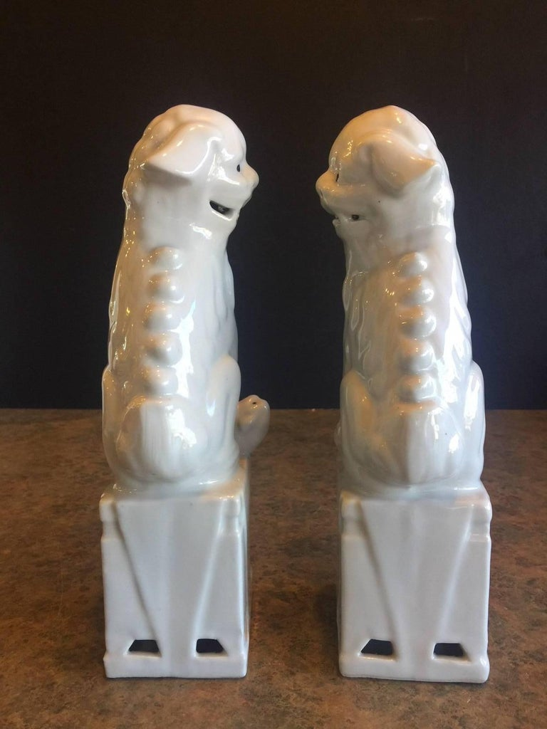 Chinese Pair of Midcentury Ceramic Foo Dogs / Bookends For Sale