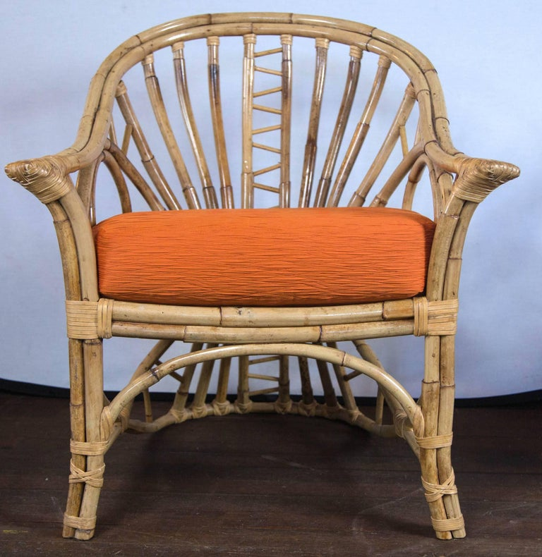Mid-20th Century Pair of Midcentury Circle Sided Rattan Arm Chairs For Sale