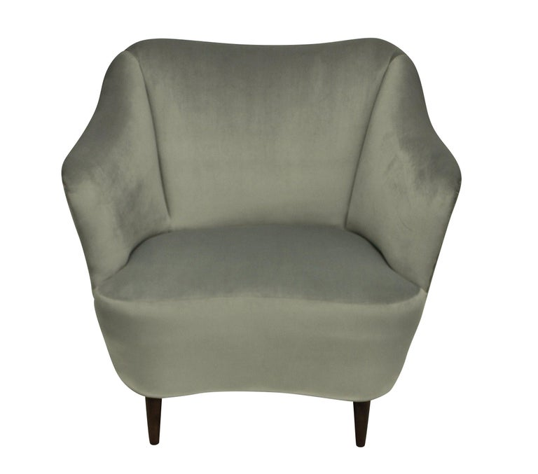 A pair of Italian midcentury cocktail chairs of sculptural design, newly upholstered in silver grey velvet.
