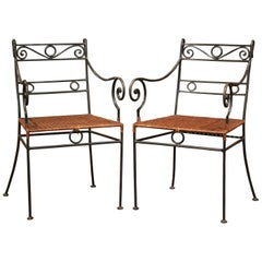 Pair of Midcentury French Painted Iron Outdoor Armchairs with Straw Seat