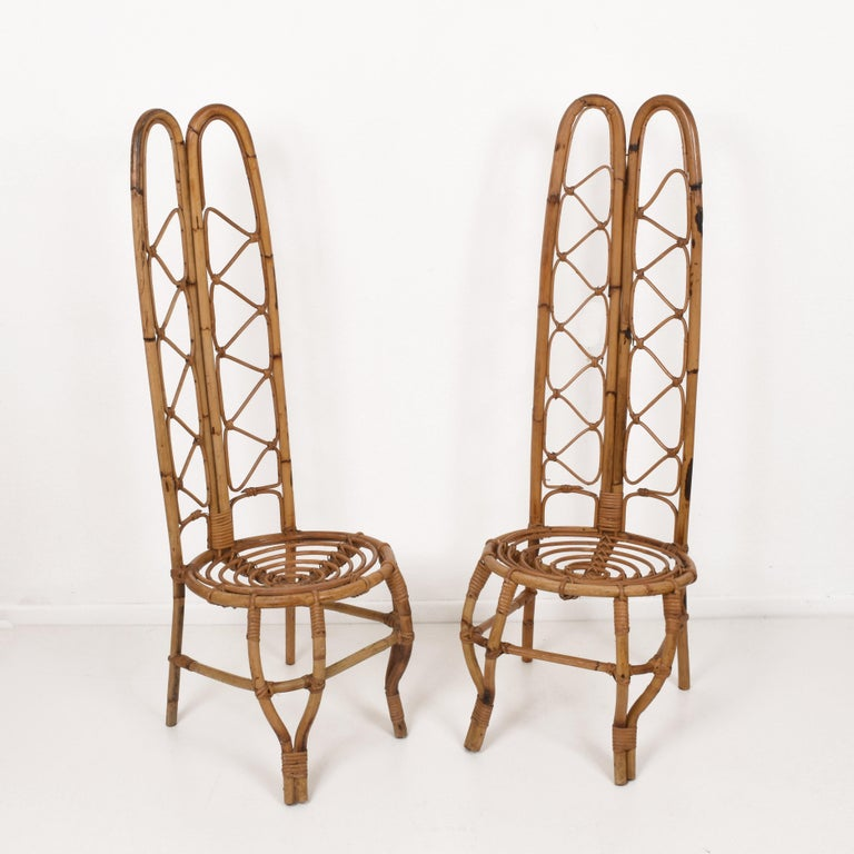 Wonderful pair of midcentury French Riviera rattan and bamboo chairs. This marvellous set was produced in France during the 1960s.  They are unique as they have a very high back seat made of mixed rattan and bamboo.  This amazing chair will give