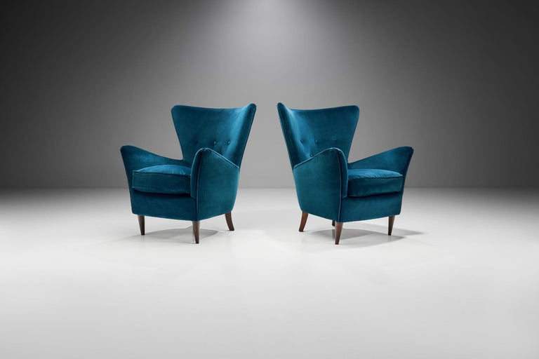This pair of striking armchairs showcases how and why Italy also excelled in the coveted Mid-Century Modern style. In these armchairs style meets functionality and quality.  Like many of the Italian armchairs of the 1950s, this pair radiates