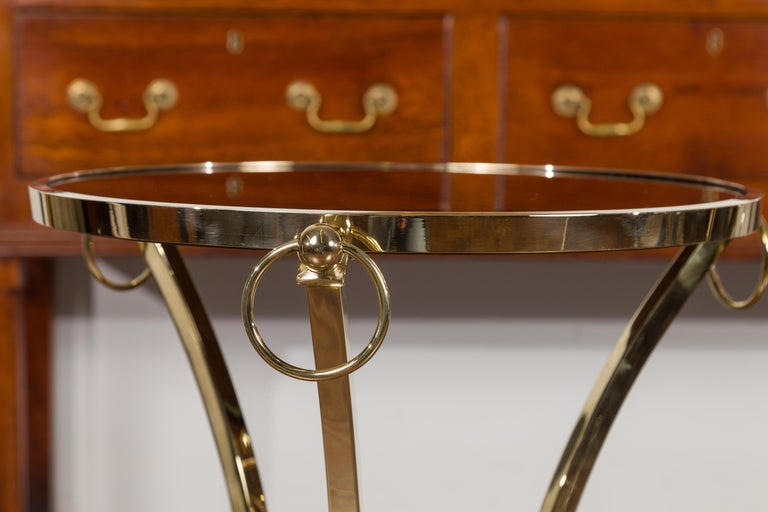 Pair of Midcentury Italian Brass Tables with Black Mirrored Tops and Ring Motifs For Sale 10