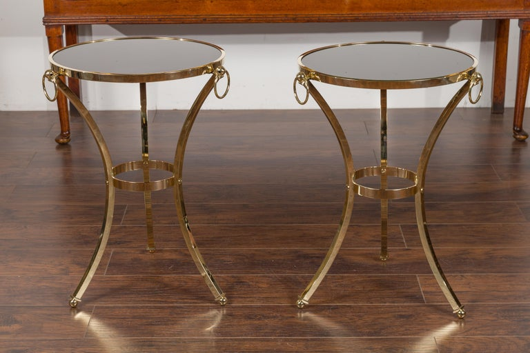 Mid-Century Modern Pair of Midcentury Italian Brass Tables with Black Mirrored Tops and Ring Motifs For Sale