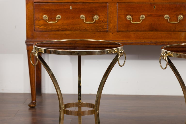 20th Century Pair of Midcentury Italian Brass Tables with Black Mirrored Tops and Ring Motifs For Sale
