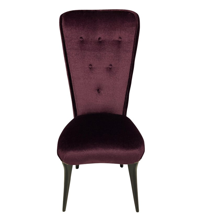 A pair of stylish Italian hall chairs with high buttoned backs and ebonized legs. Newly upholstered in aubergine mohair velvet.