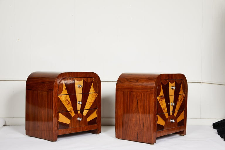 Pair of fine quality midcentury Italian veneered side tables or nightstands of rosewood containing three graduated drawers with fan inlay of Birdseye maple and mahogany. The vintage tables are beautifully finished on all sides and inside the drawers.