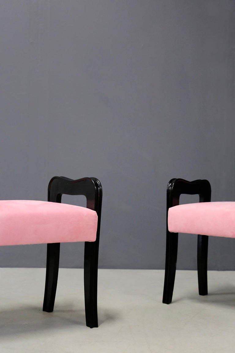 Pair of Italian stools attributed to designer Paolo Buffa from circa 1950. The stools have been restored and lined in pink velvet. The pair is made of ebonized wood and has slight defects due to age and use. The peculiarity of the product are its