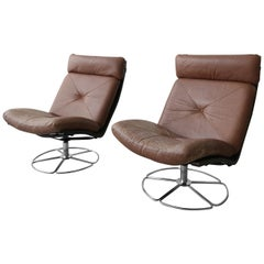 Pair of Midcentury Leather and Chrome Armless Swivel Danish Style Lounge Chairs