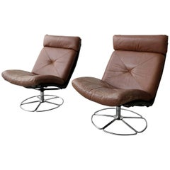 Pair of Midcentury Leather and Chrome Swivel Lounge Chairs