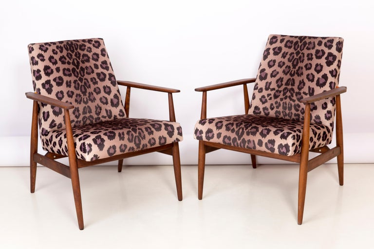 A beautiful, restored armchairs designed by Henryk Lis. Furniture after full carpentry and upholstery renovation. The fabric, which is covered with a backrest and a seat, is a high-quality italian velvet upholstery printed in leopard pattern. The