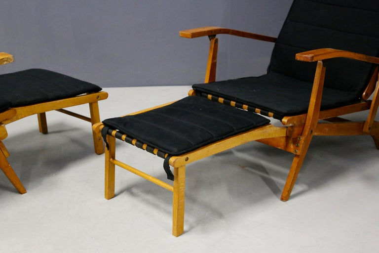 Pair of deckchairs attributed to Studio BBPR from 1950. The chairs are made of cherrywood. Inside them we find an interlocking mechanism that allows the exit of the stool / ottoman. The stool through the interlocking is easily closable right the