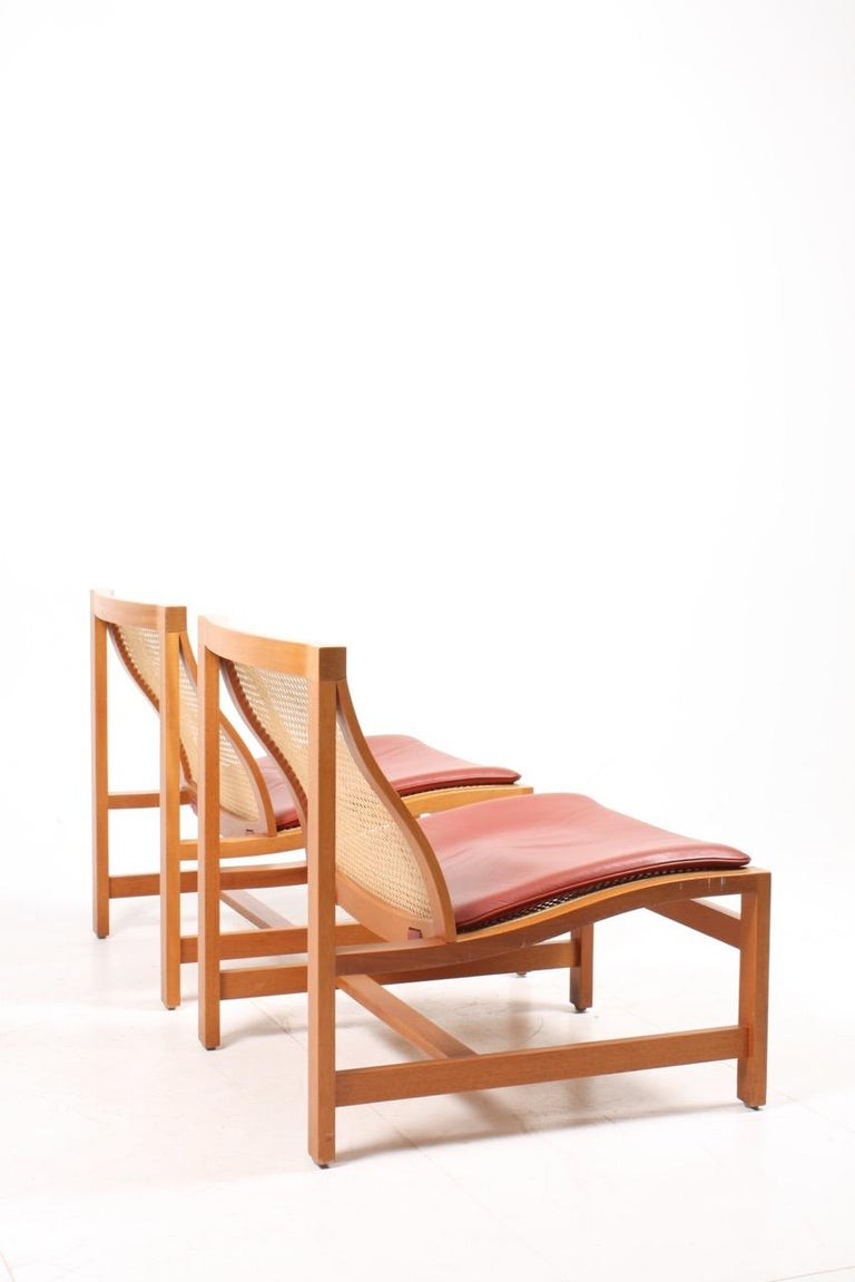 Cane Pair of Midcentury Lounge Chairs by in Beech and Patinated Leather, Danish For Sale