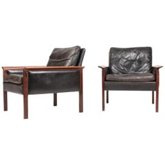 Pair of Midcentury Lounge Chairs in Patinated Leather and Rosewood by Hans Olsen