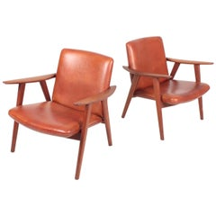 Pair of Midcentury Lounge Chairs in Patinated Leather by Hans Wegner, 1950s