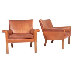 Pair of Midcentury Lounge Chairs in Patinated Leather by Hans Wegner, 1960s