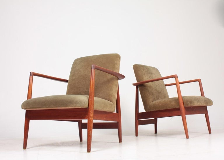 Pair of lounge chairs in oil finished teak and velvet. Designed and made by cabinetmaker C.B. Hansen. Great condition.