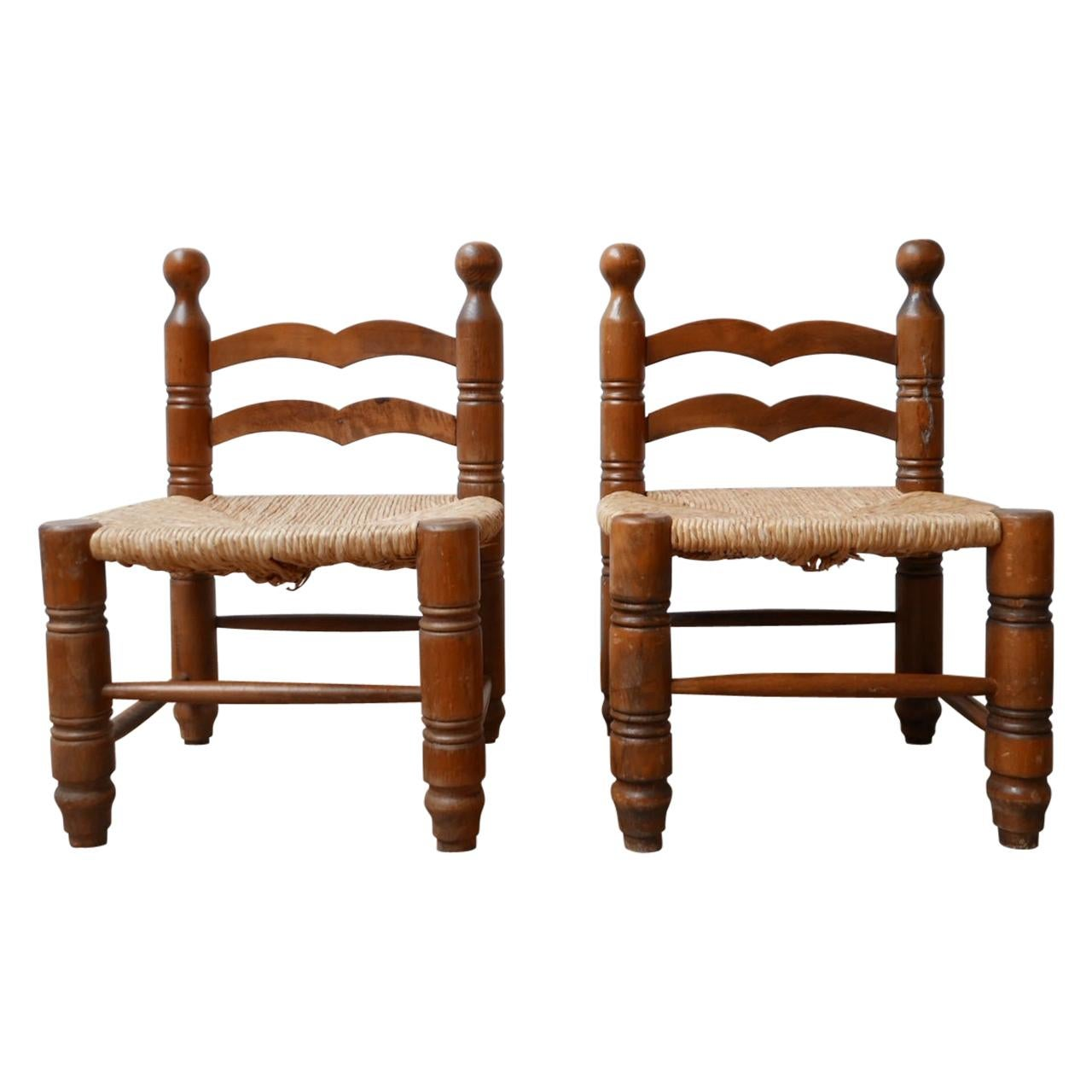 Pair of Midcentury Low Rush Armchairs Attributed to Charles Dudouyt
